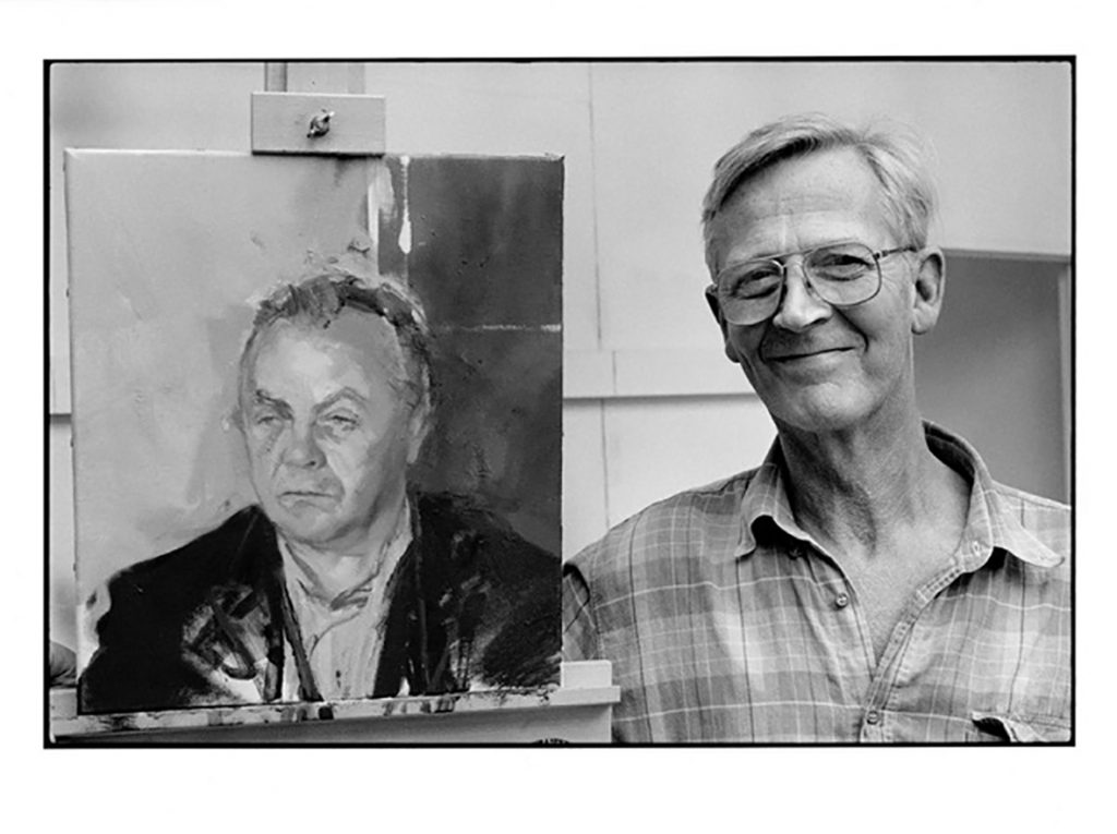 Michael Andrews in his studio with his portrait of Bruce Bernard', circa 1990. Photograph © Estate of Bruce Bernard.
